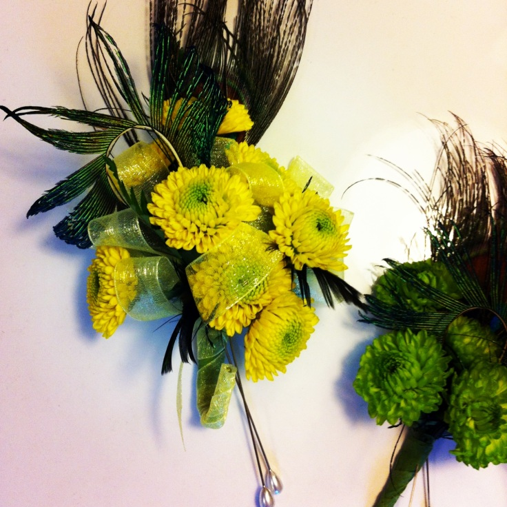 peacock corsage and boutonniere